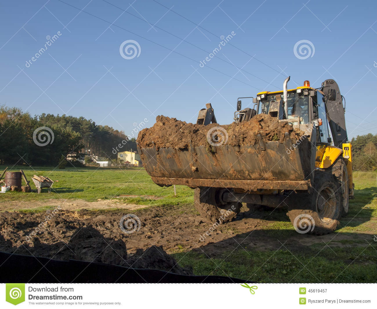 Wheel loader during backfilling around the foundation of for Best backfill material for foundation
