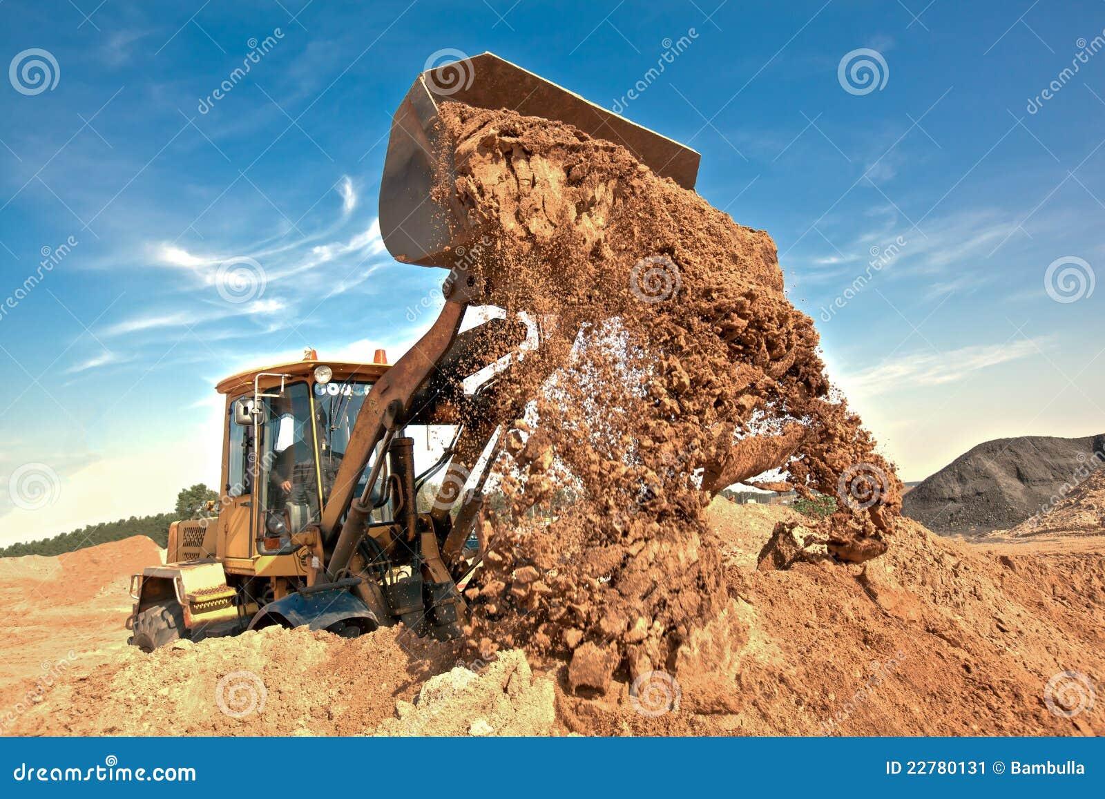 Construction Site Soil : Wheel loader unloading soil at construction site stock
