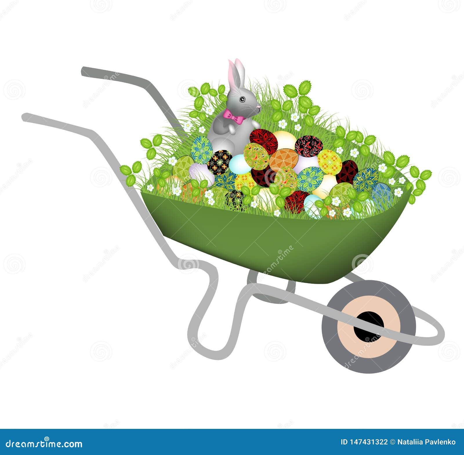 Wheelbarrow z wiosny traw? Szarego szarego kr?lika maluj?cych Wielkanocnych jajek i Symbol wielkanoc w kulturze du?o