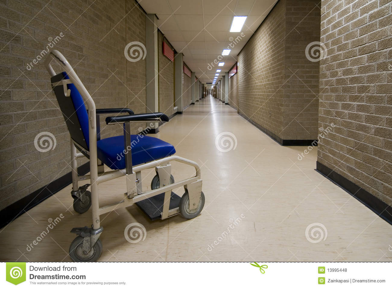 Wheelchair in an empty NHS hospital corridor