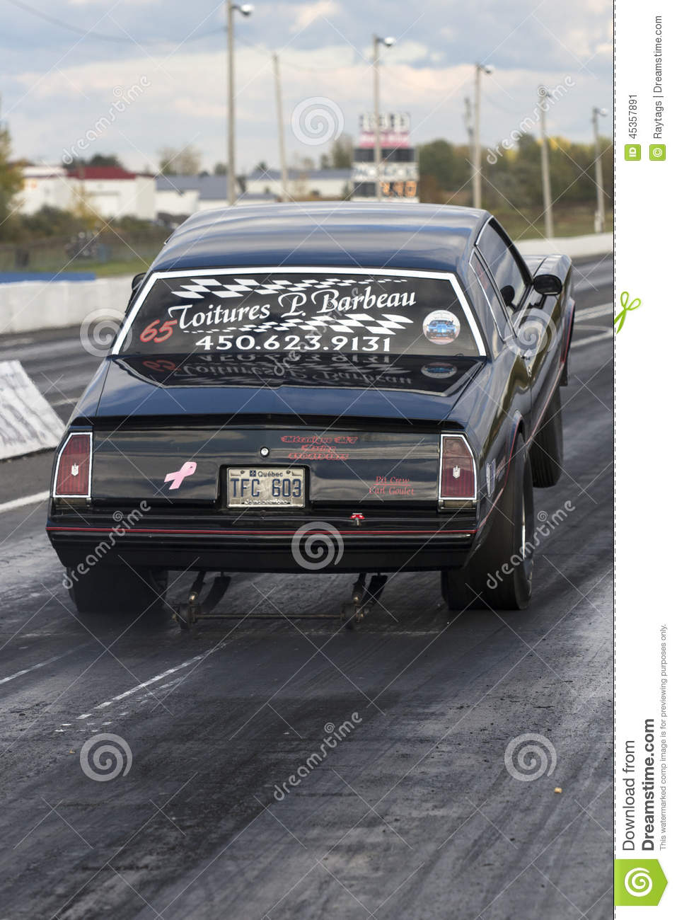 Napierville September 13, 2014 Rear View Of Chevrolet Monte Carlo Making A  Wheelie On The Track During Drag Event.