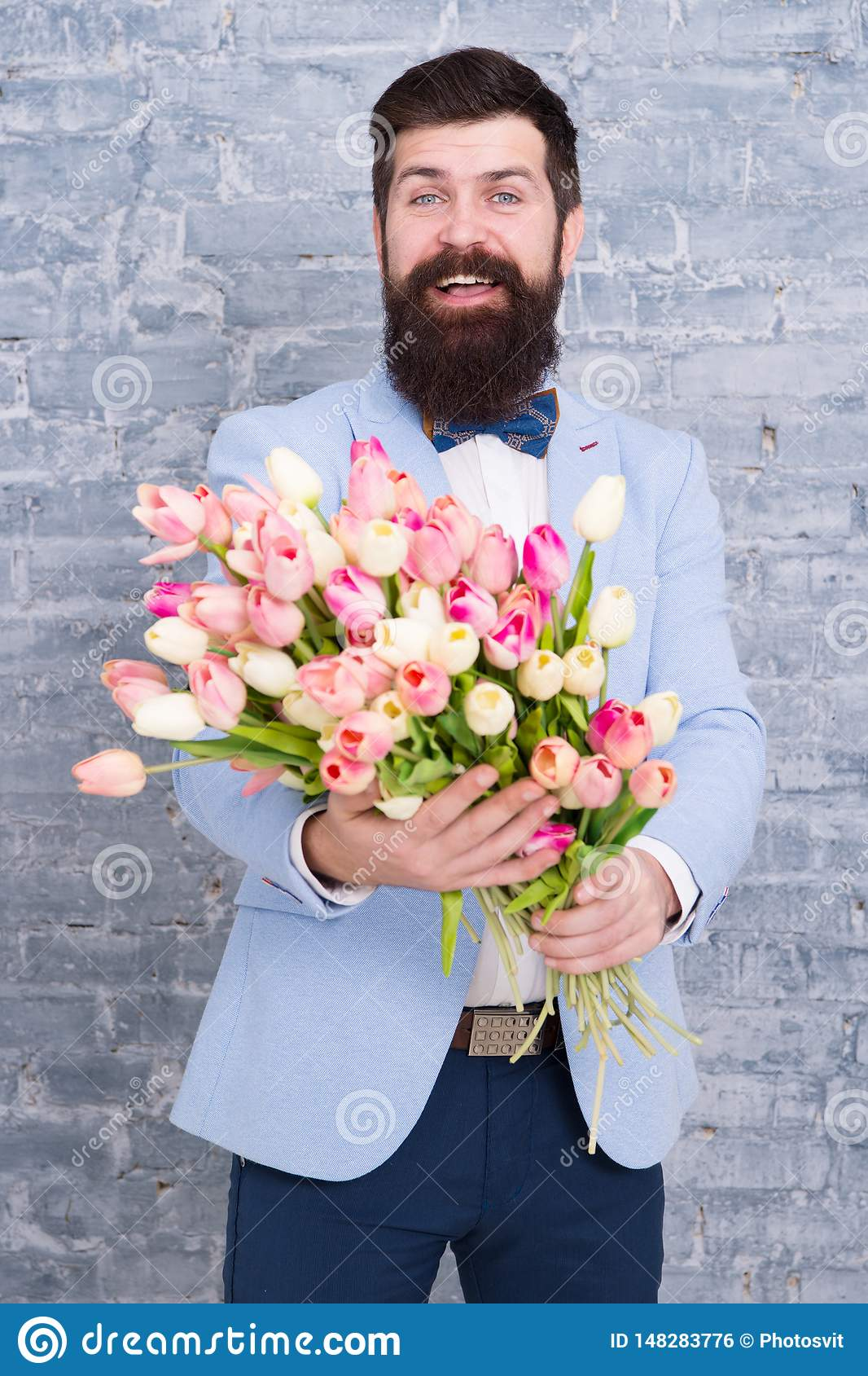 Where dreams become reality. Womens day. Flower for March 8. Spring day. Bearded man with flowers. Bearded man with