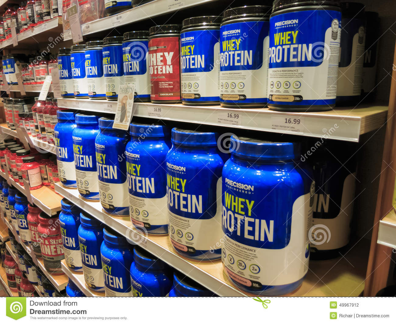 Whey Protein Jars On Store Shelf Editorial Photography