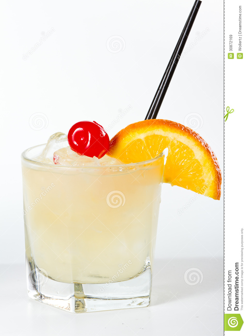 Traditional whiskey sour cocktail served on the rocks garnished wiht a ...