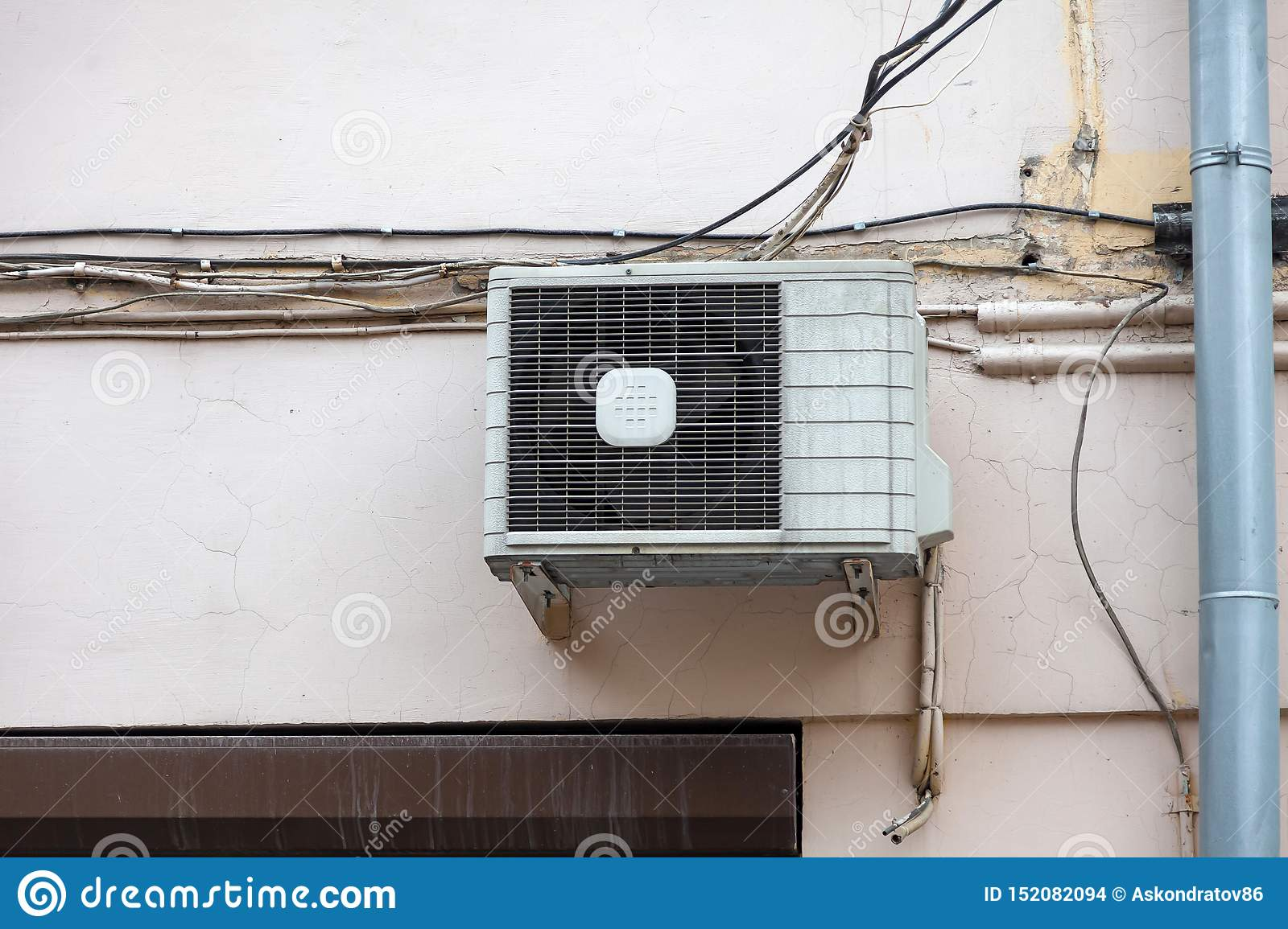 White Air Conditioning On The Old Wall Of The House With The ... on
