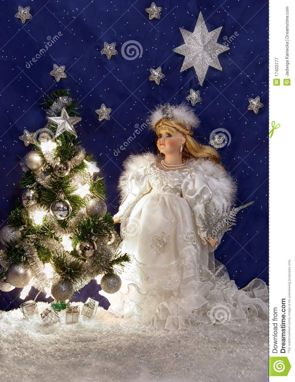 White angel and christmas tree