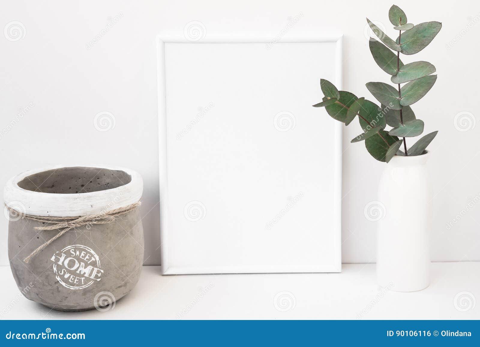 White background frame mockup, green eucalyptus in ceramic vase, cement pot, styled image