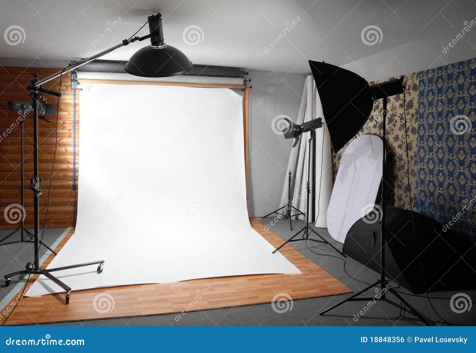 White background inside studio - lighted lamps