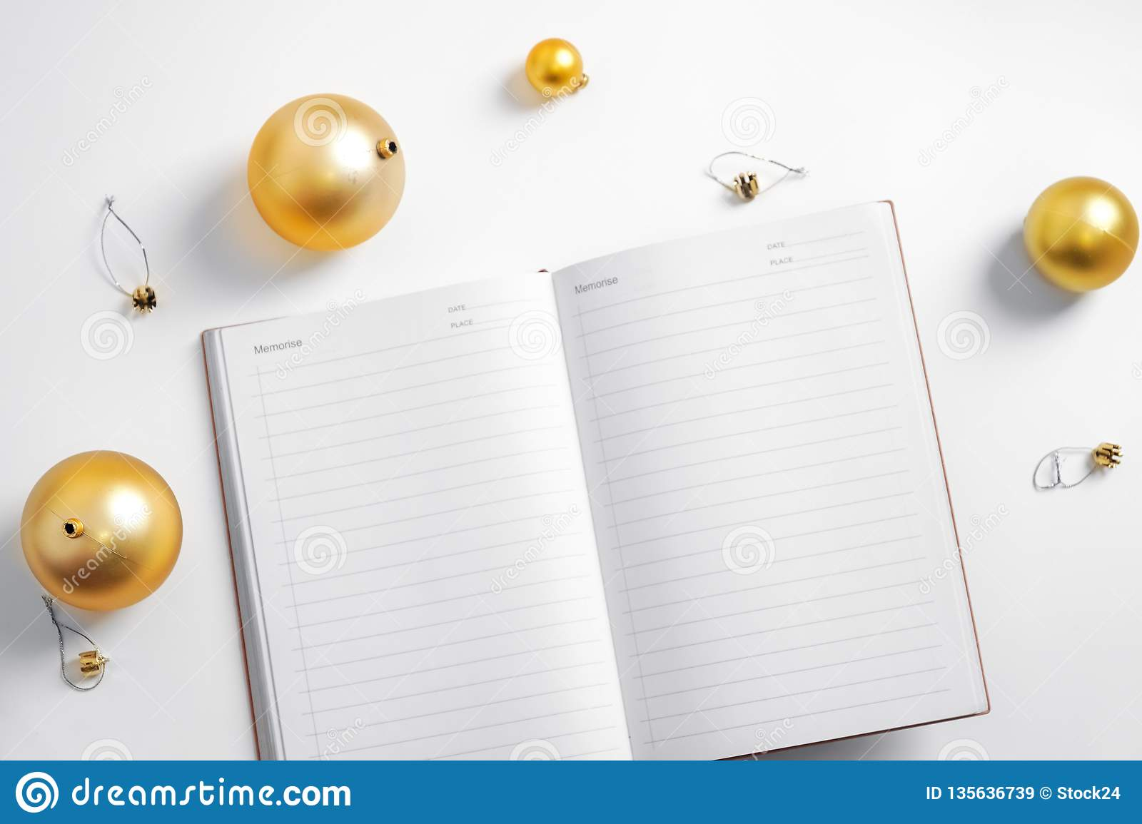 White background notepad hand writing new year resolution golden ball planning life smart goals