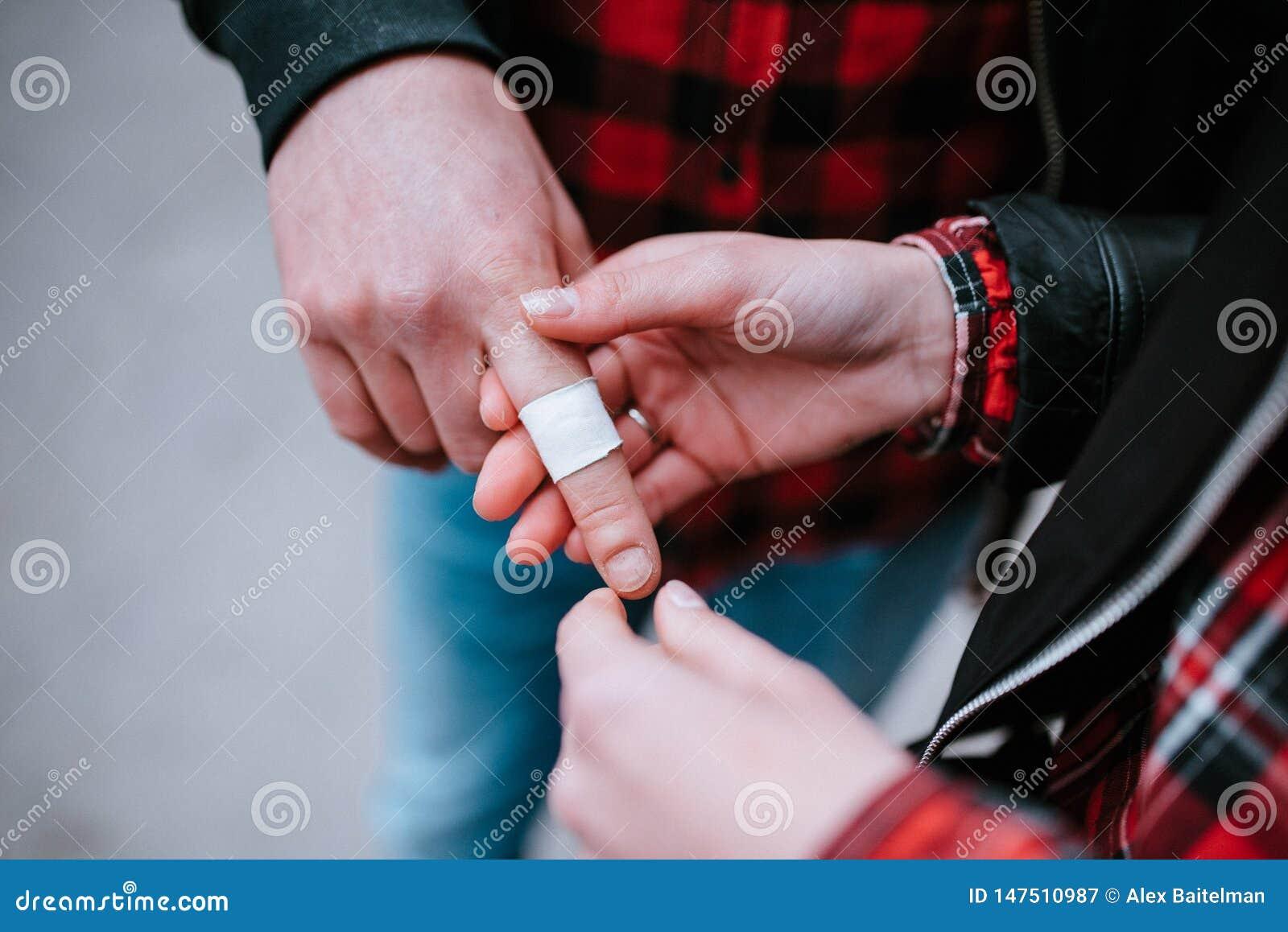 white bactericidal plaster on finger close up