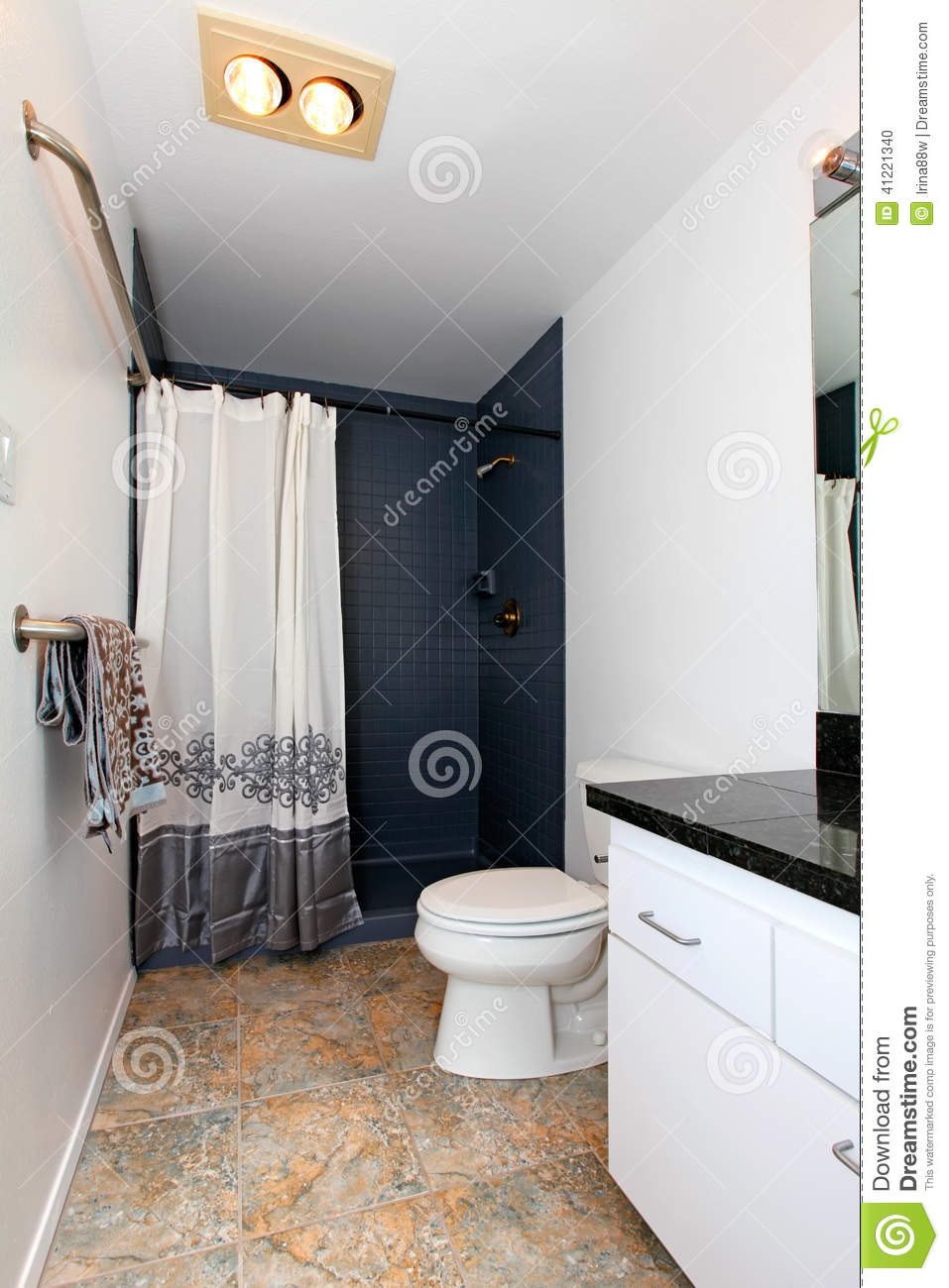 White Bathroom With Navy Tile Wall Trim Stock Photo
