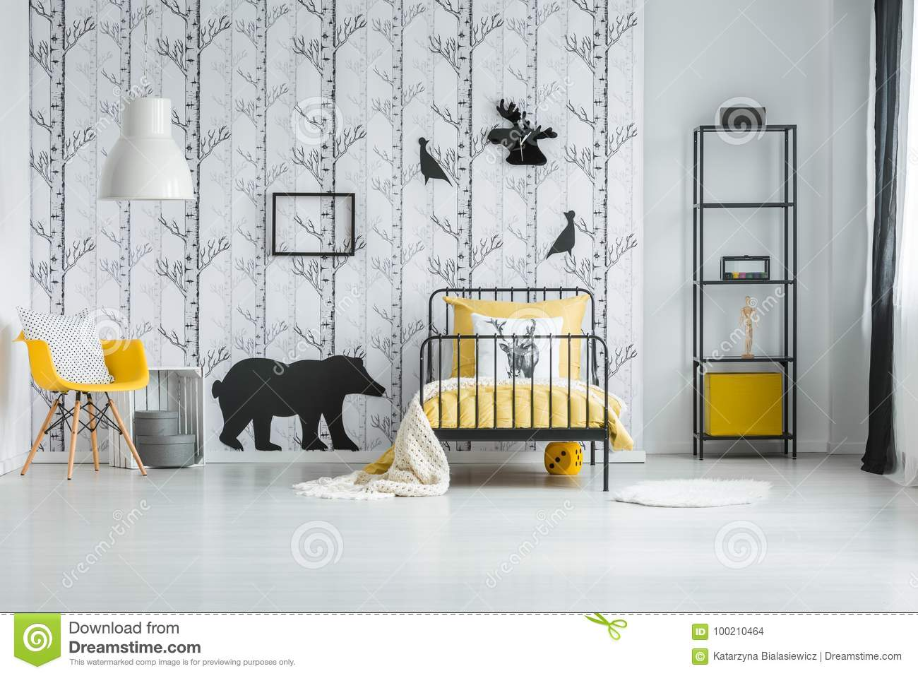 White blanket on yellow overlay on bed in white bedroom with yellow chair against inspiring wallpaper