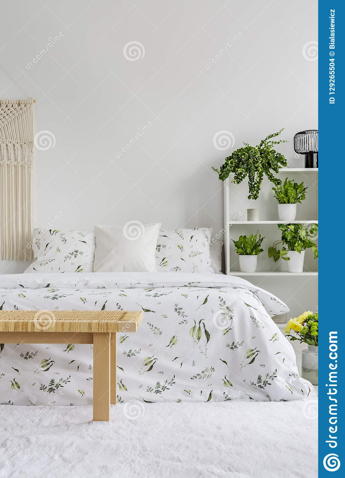White Bedroom Interior With Fresh Plants On Rack, Floral ...