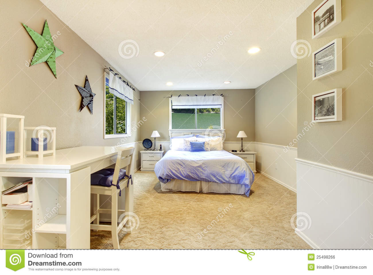 white and beige bedroom interior with blue bed. royalty free stock