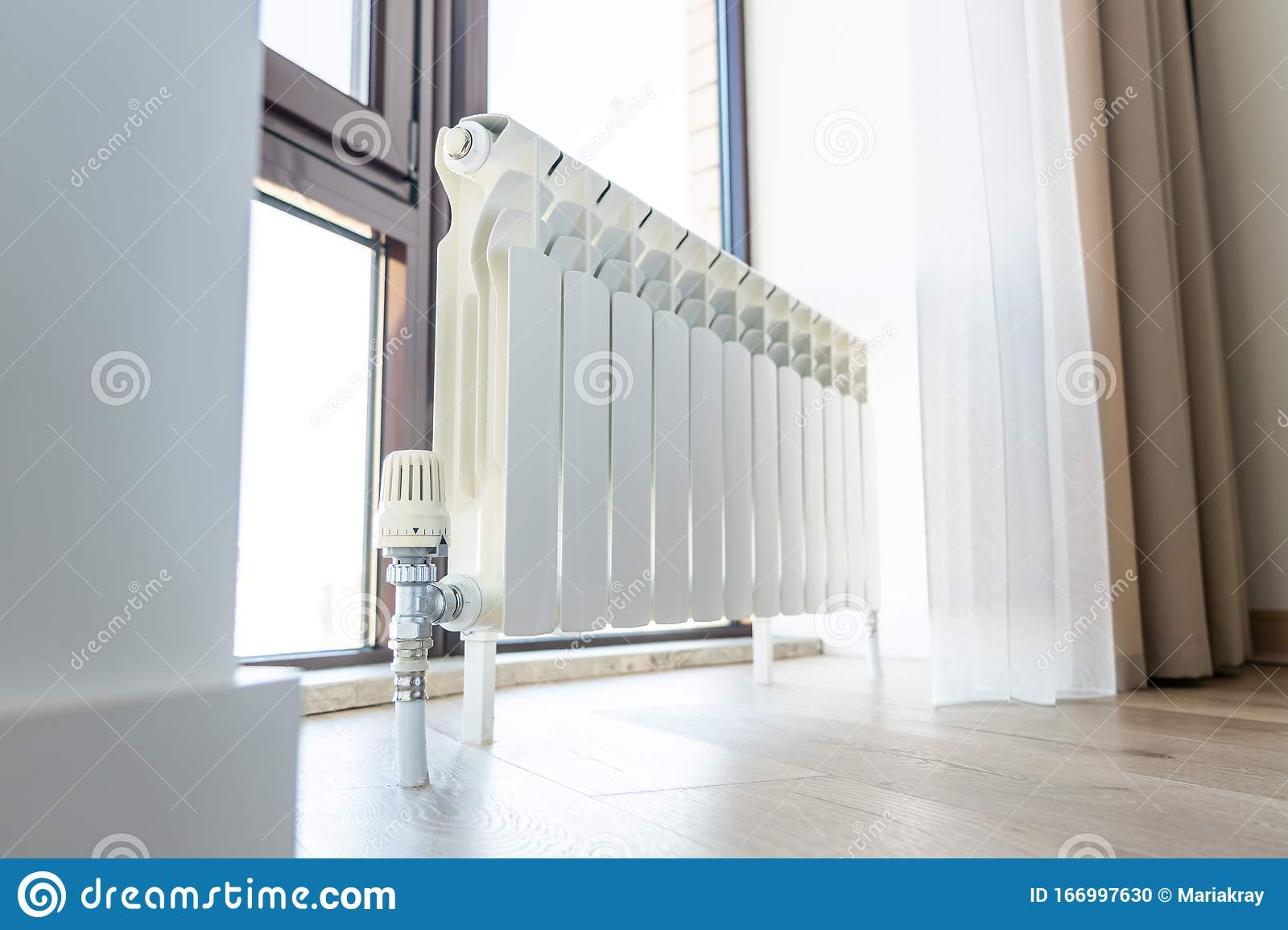 White Big Radiator With Thermostat Near Window In Modern Room Stock Photo Image Of Metal System 166997630