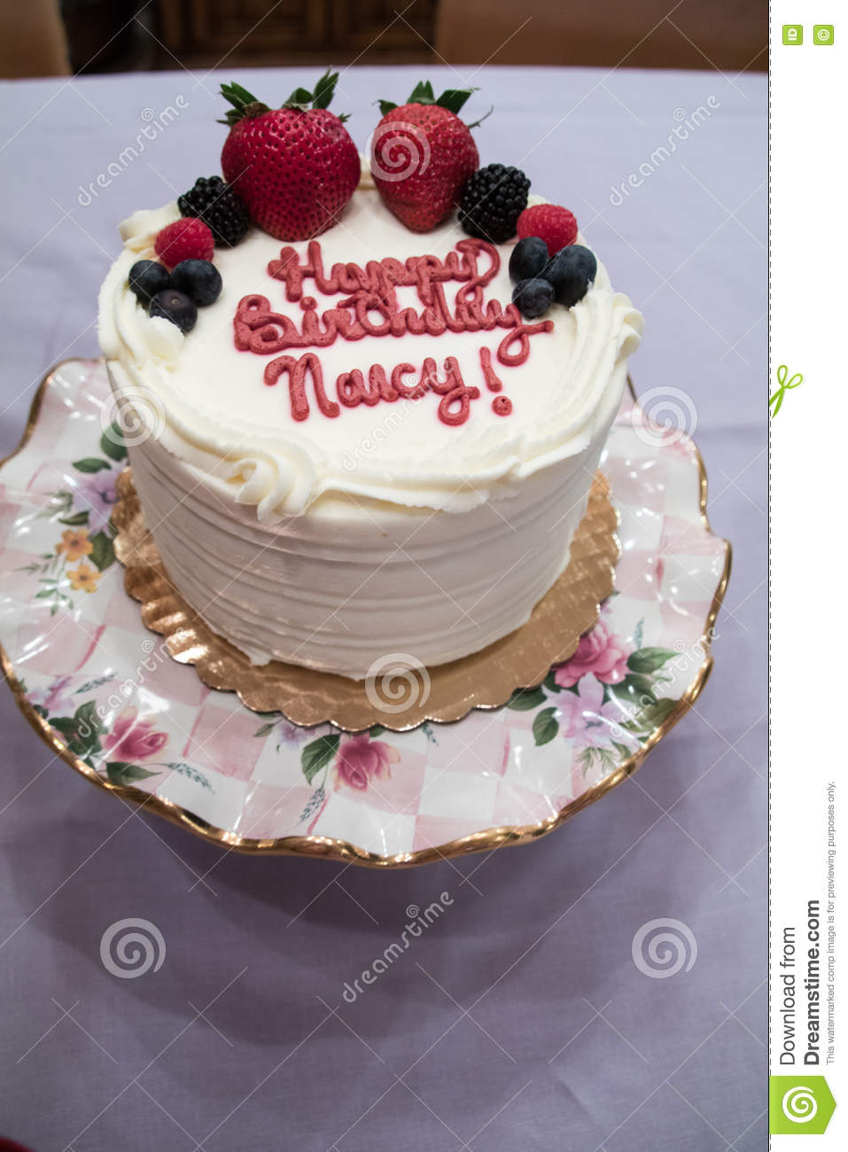 White Birthday Cake Made With White Frosting And Strawberries And