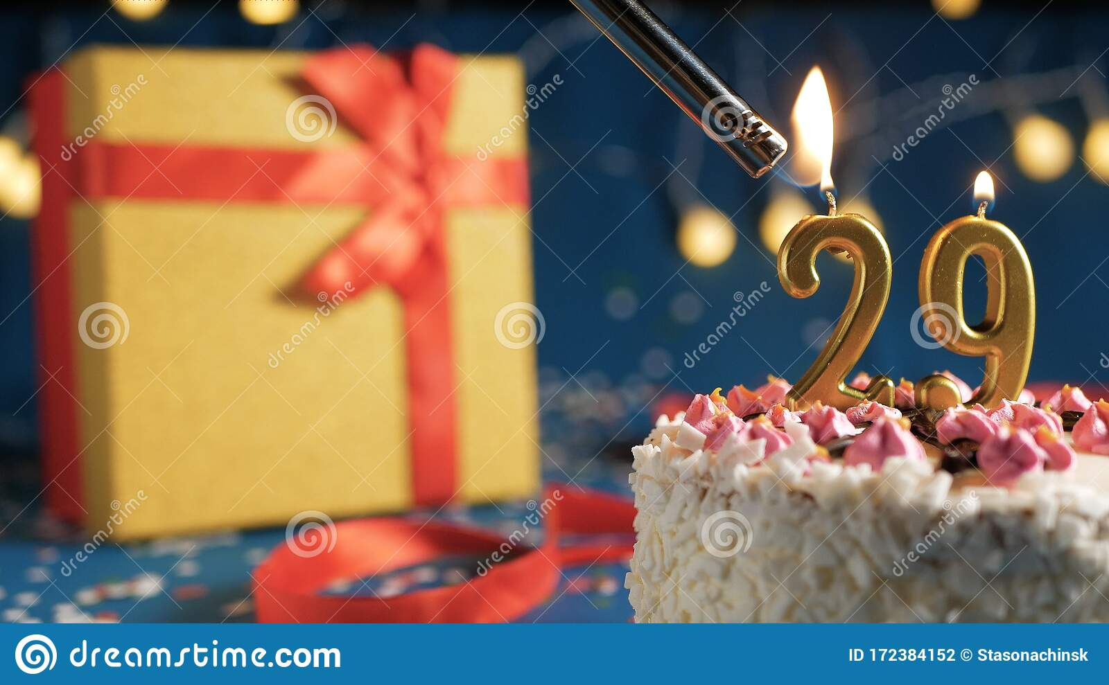White Birthday Cake Number 29 Golden Candles Burning By Lighter  Blue Background With Lights And