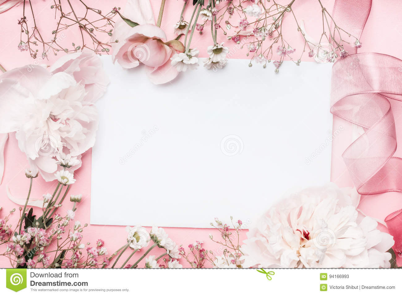 White blank card with pastel flowers and ribbon on pink pale background, floral frame. Creative greeting, Invitation
