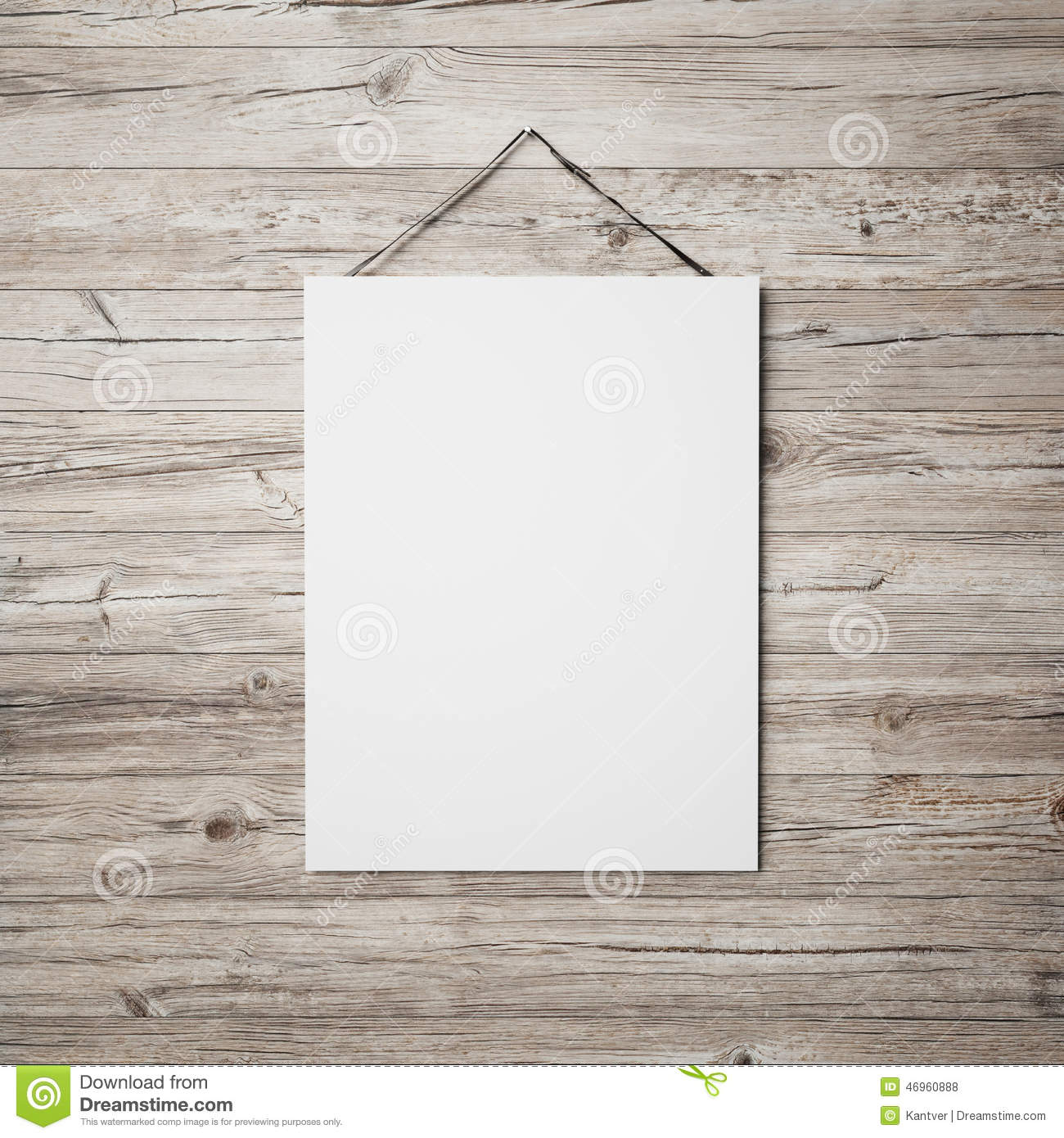 White blank poster hanging on leather belt on wood background