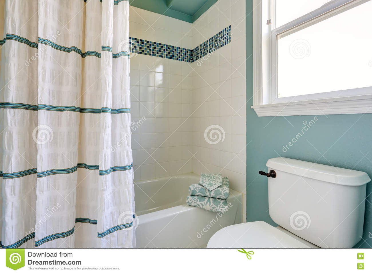 white and blue bathroom interior with mosaic tile trim stock photo