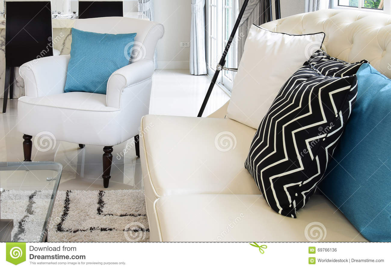 Stupendous White And Blue Pillows On A White Leather Couch Stock Photo Ncnpc Chair Design For Home Ncnpcorg