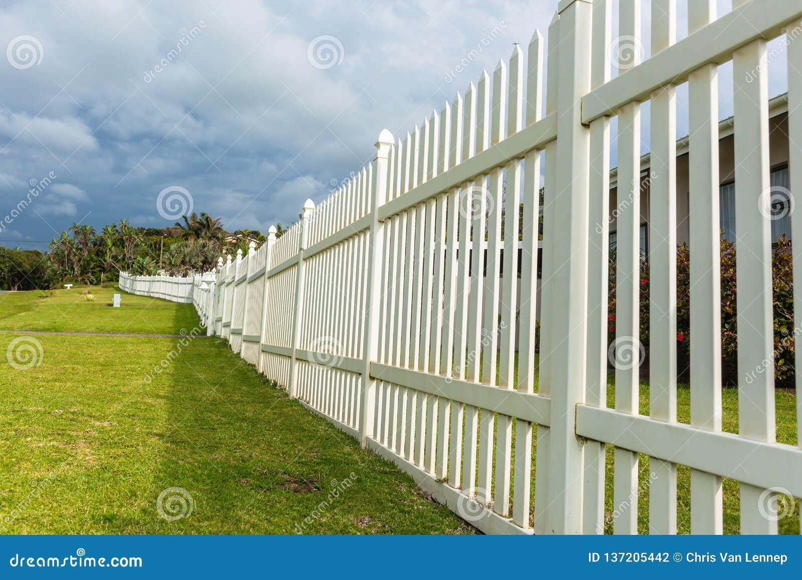 White Boundary Vertical Slat Fence