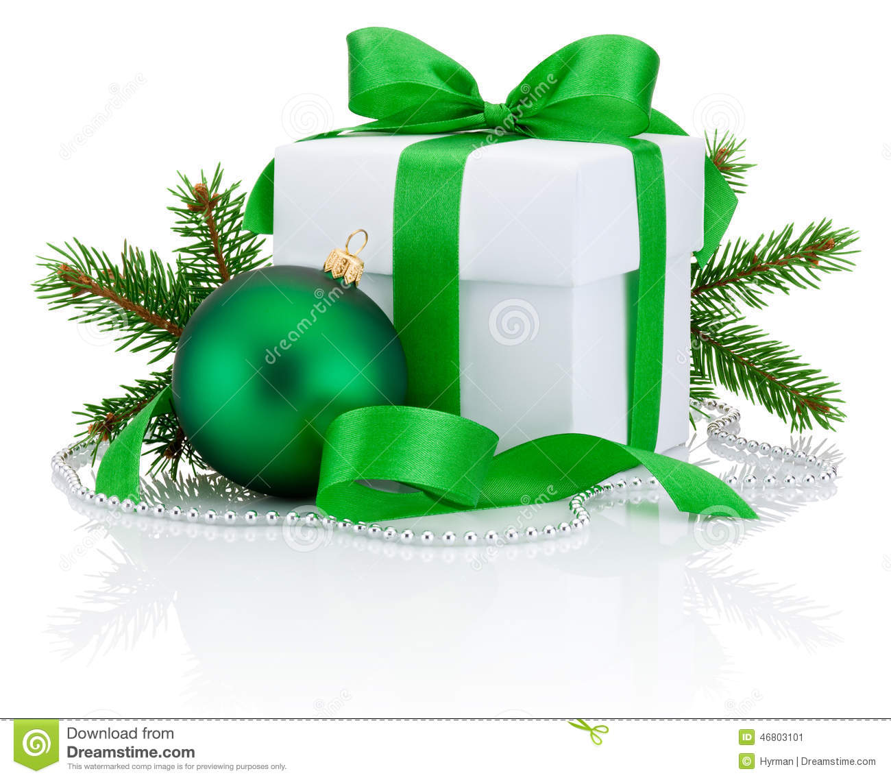 White box tied green ribbon bow pine tree branch and