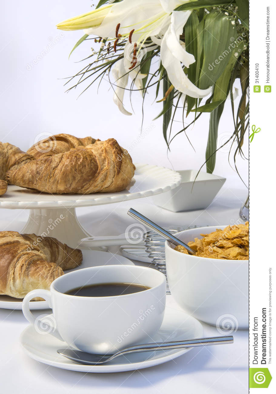 Table Setting For Breakfast White Breakfast Table Setting With Lily Flowers Stock Photo