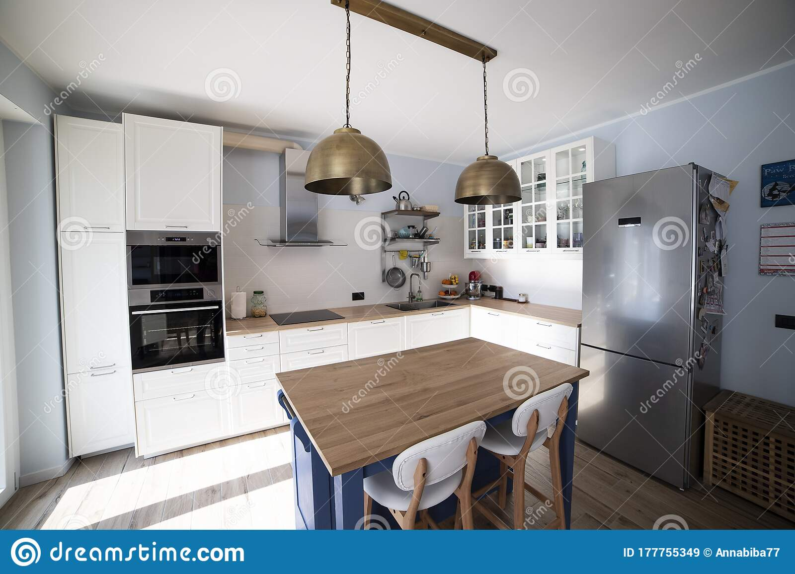 White Kitchen With Blue Island Stock Image Image Of Kitchen Island 177755349