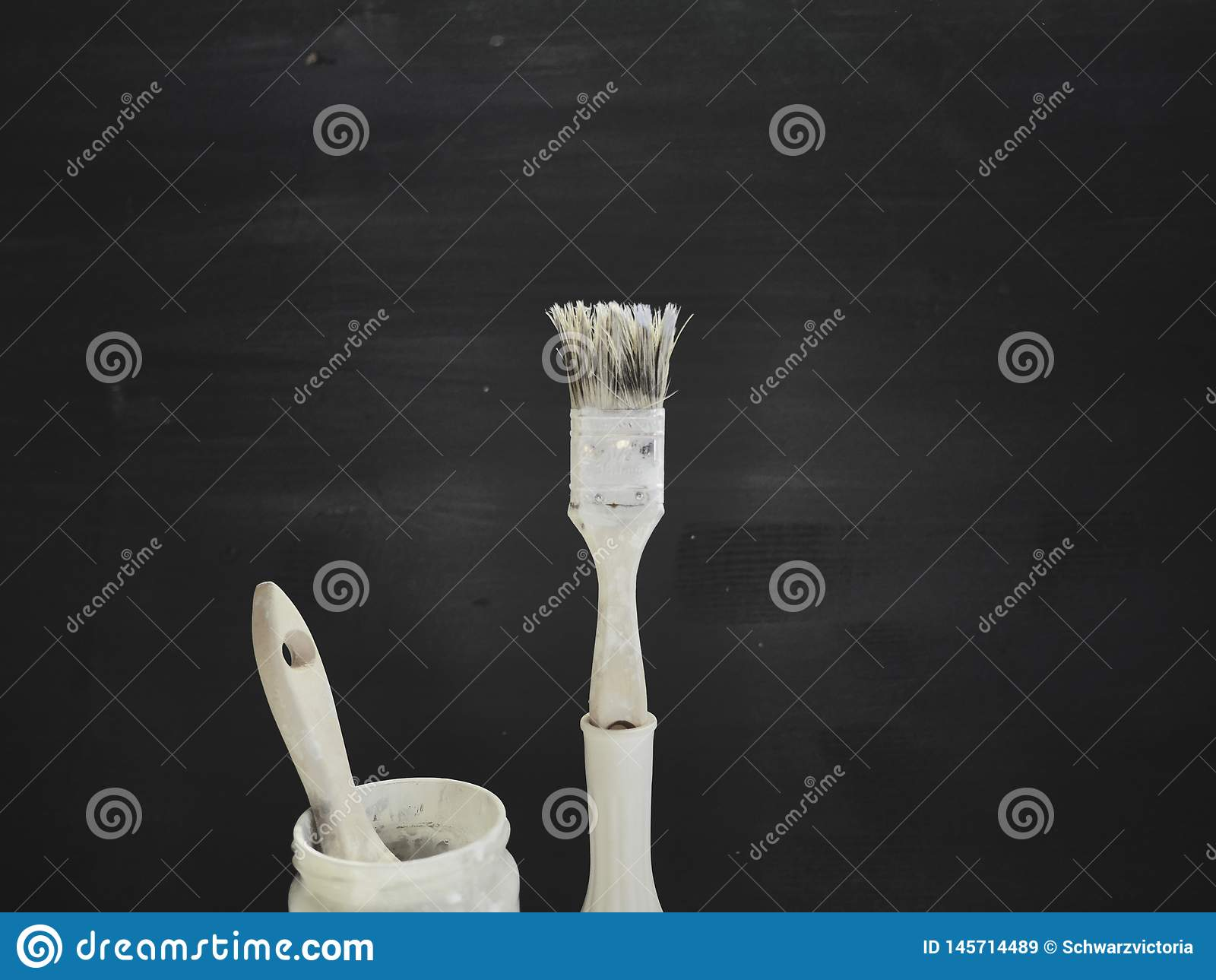 White Brush in front if dark painted background