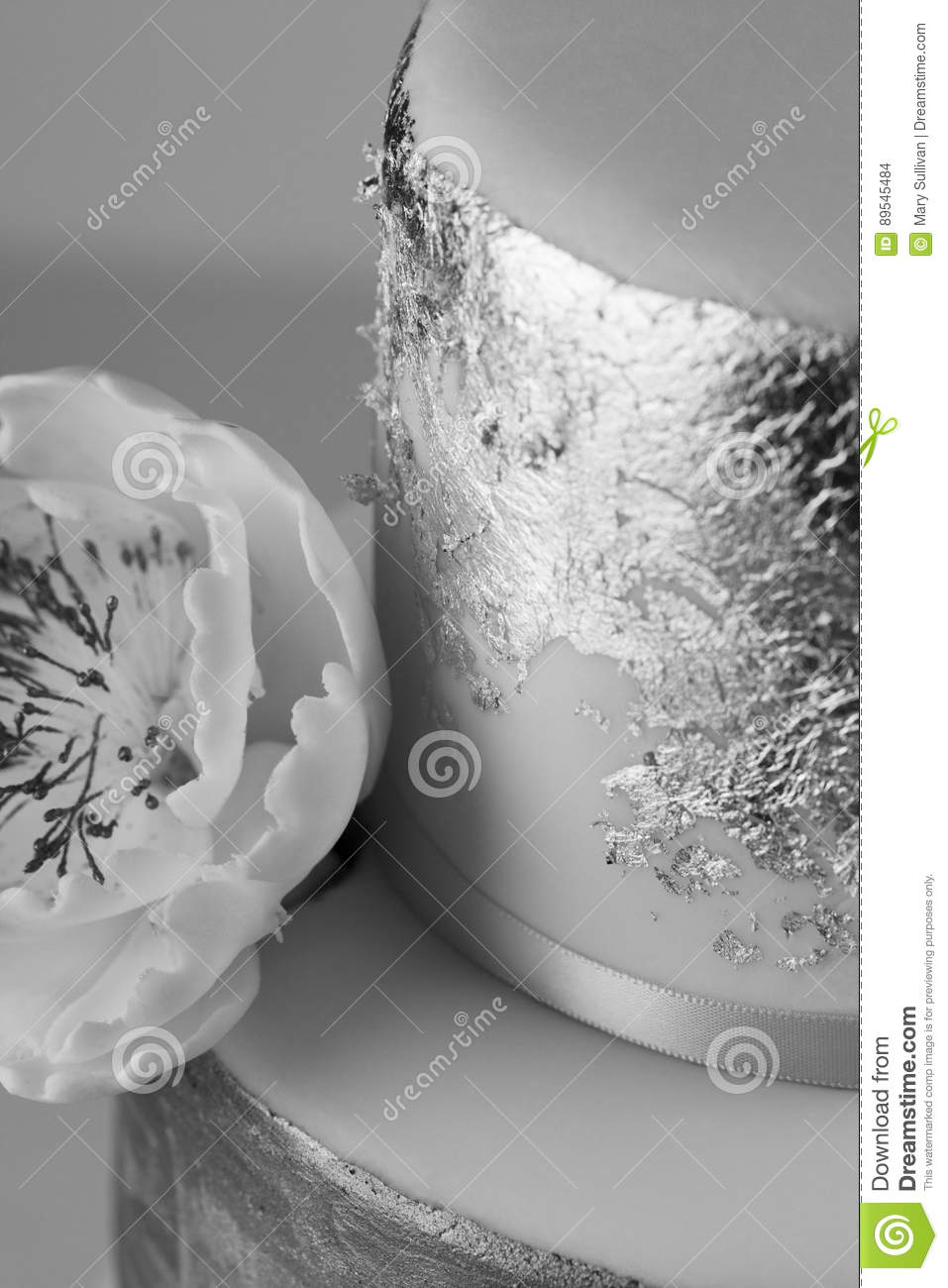 Silver Leaf Decoration White Cake With Silver Leaf Decoration And Icing Sugar Flower