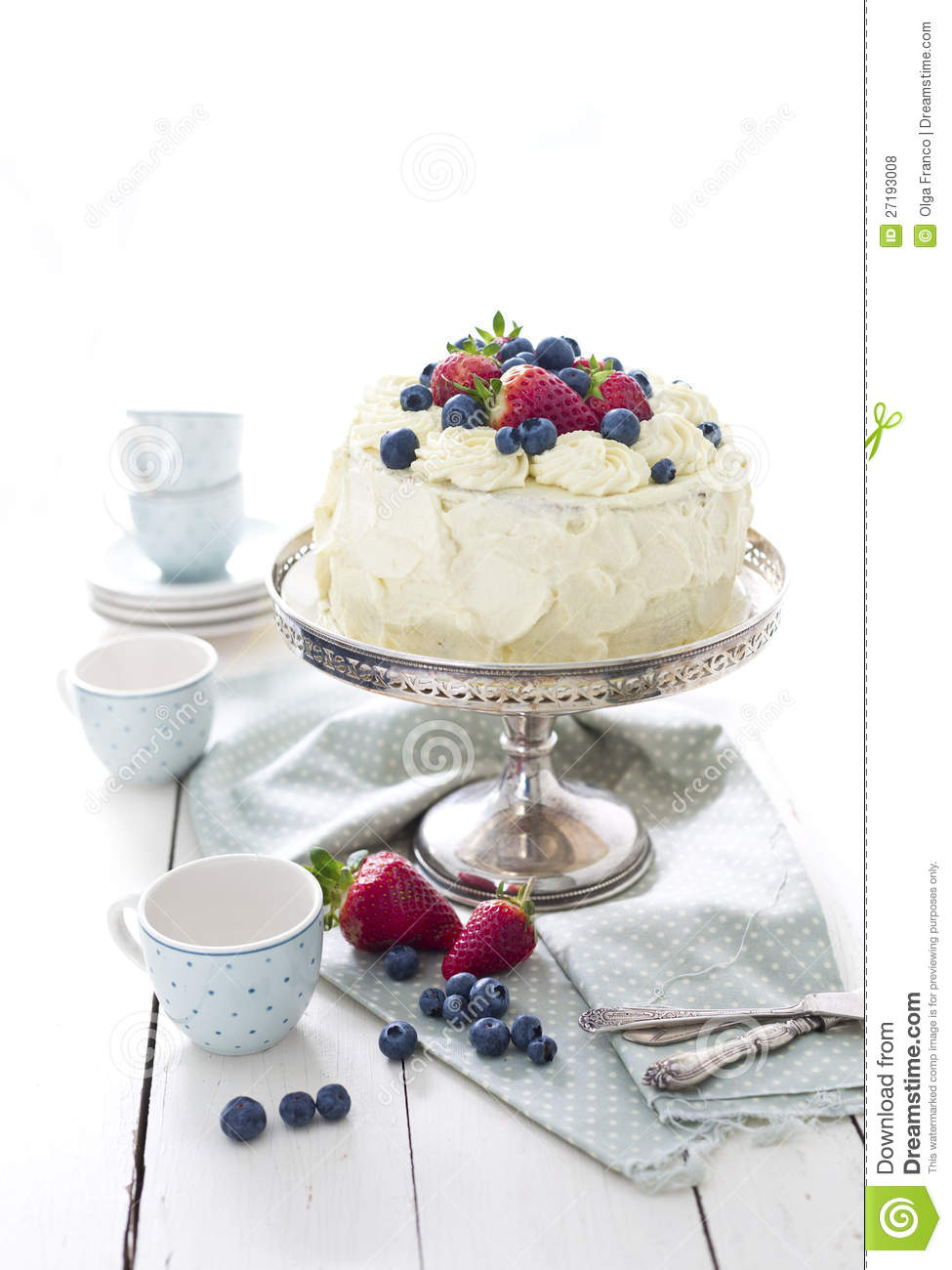 White Cake With Berries And Whipped Cream Frosting