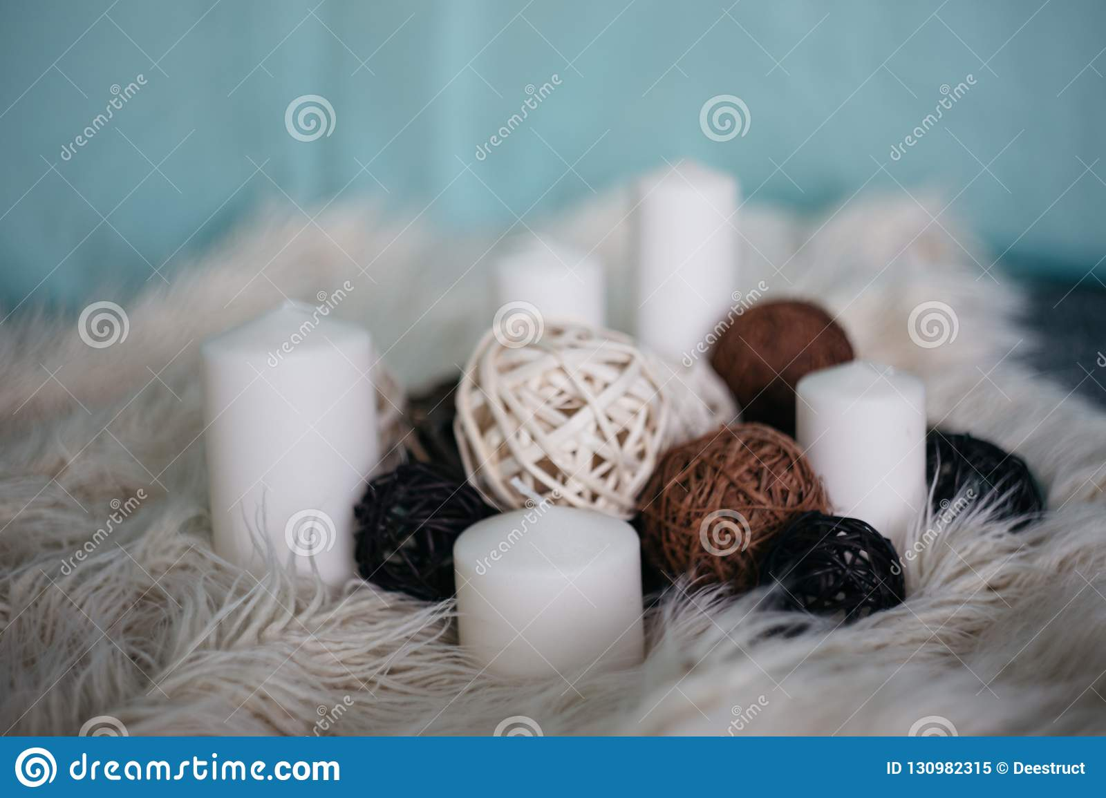 white candles and decor items on white carpet