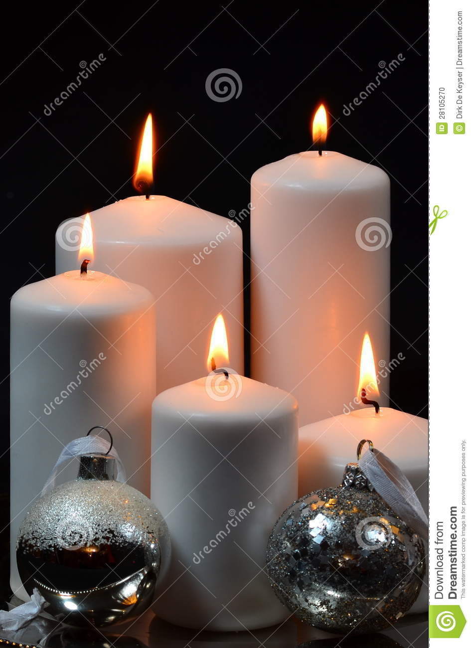 White candles with silver christmas balls