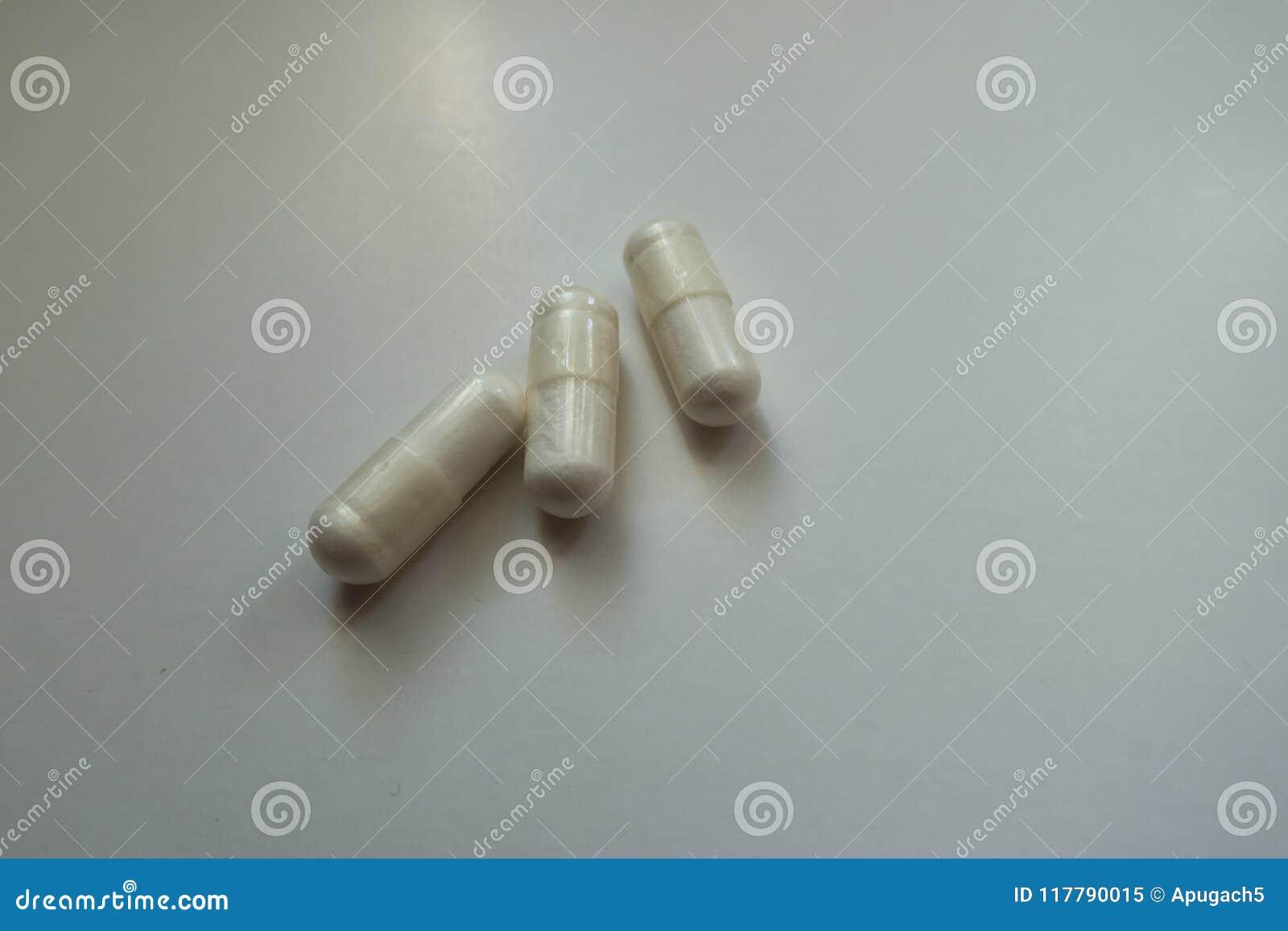 White Capsules Of Magnesium Citrate 3 Items Stock Image