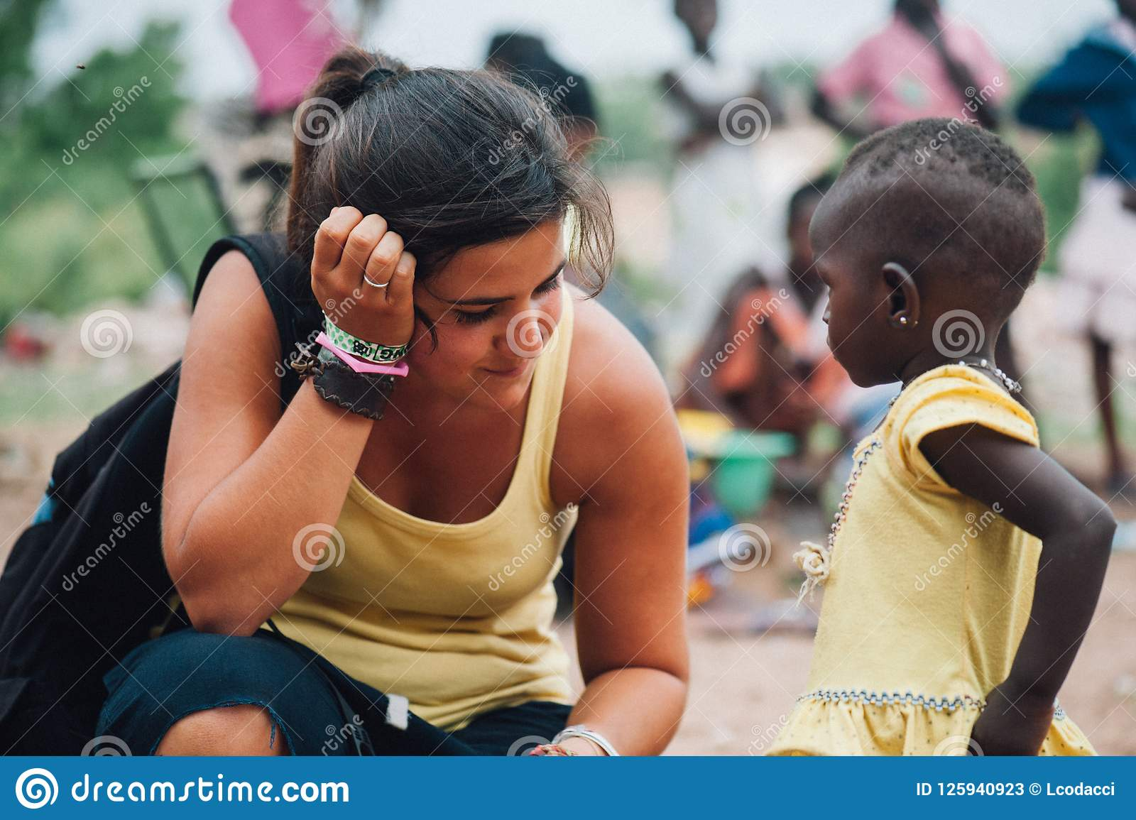 White Caucasian Young Woman Plays With Black African People In A Rural Village Editorial Stock Photo Image Of African Outside 125940923