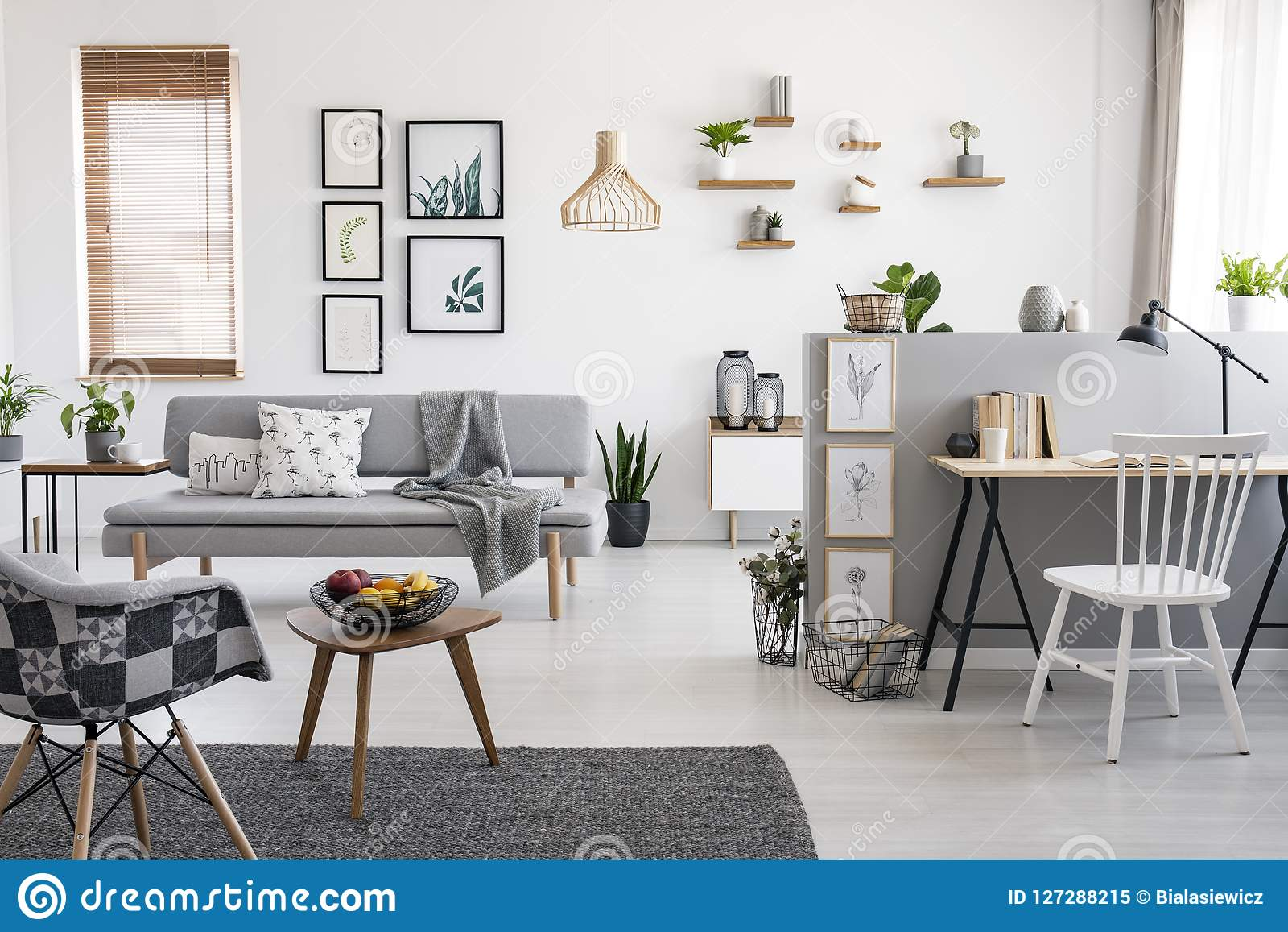 White Chair At Desk In Spacious Apartment Interior With Gallery