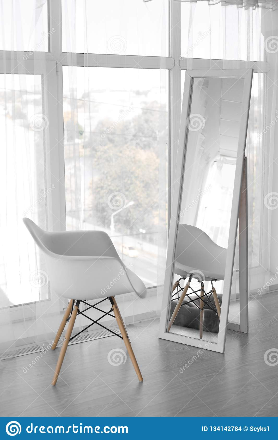 White chair at the large mirror. white chair