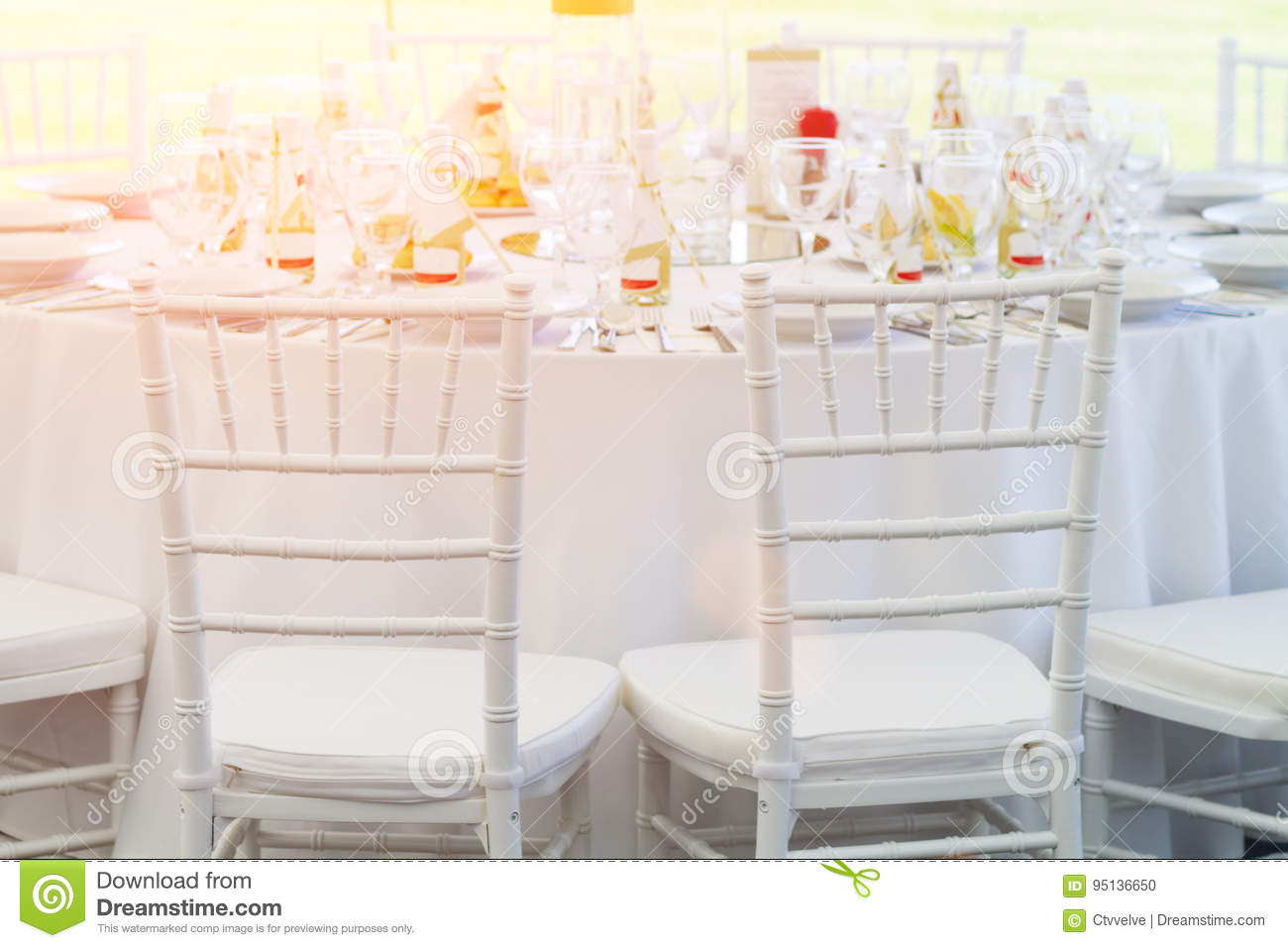 White Chairs And Fancy Table Set For A Wedding Dinner Stock Photo Image Of Fancy Chair 95136650