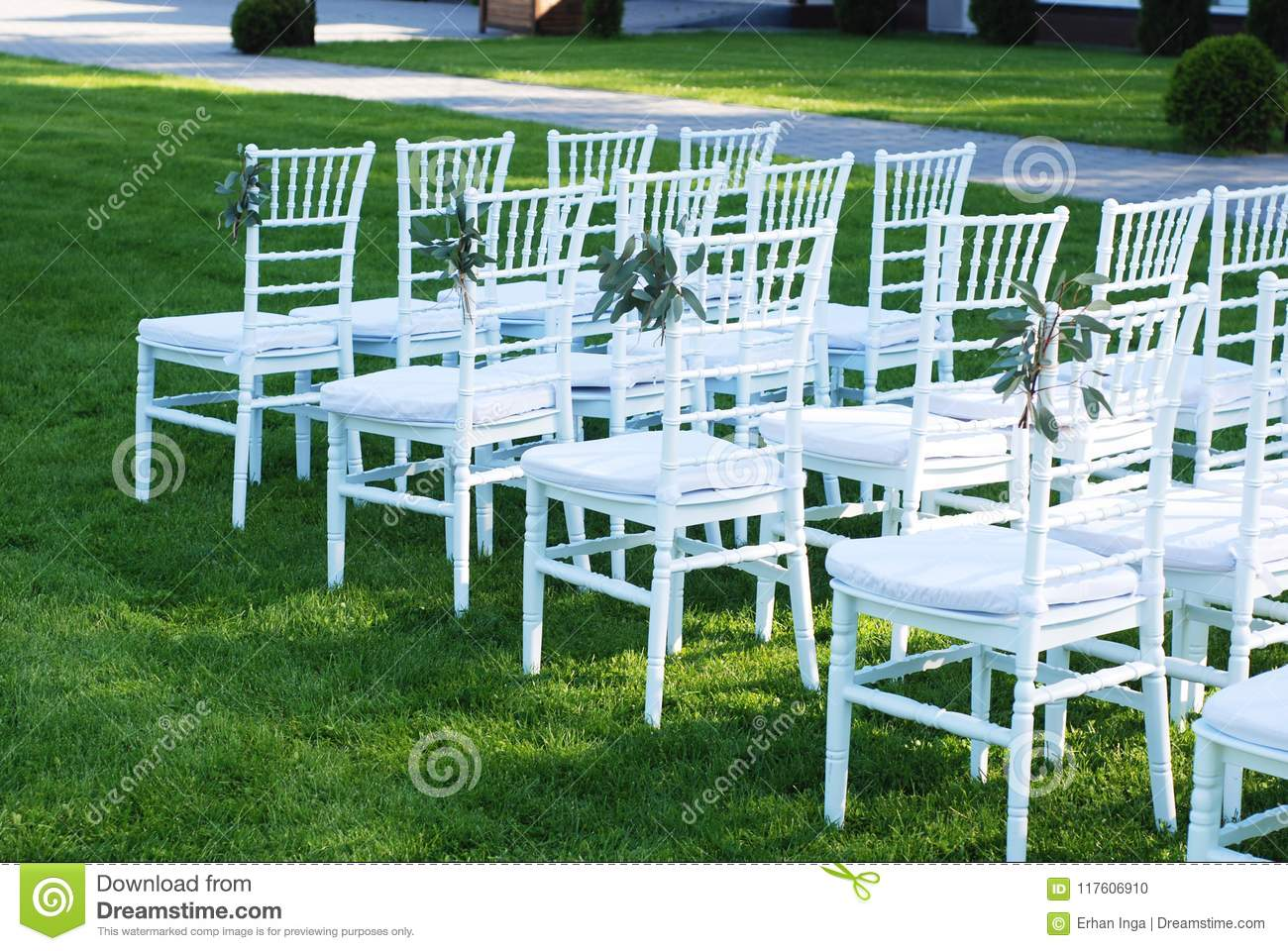 White Chairs At The Outdoor Wedding Ceremony Green Grass Background Party Celebrate Wedding Event Stock Photo Image Of Couple Celebration 117606910