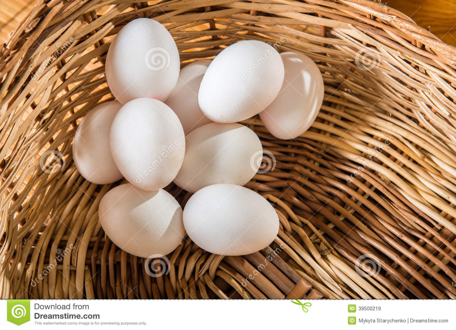 White chicken eggs on the basket