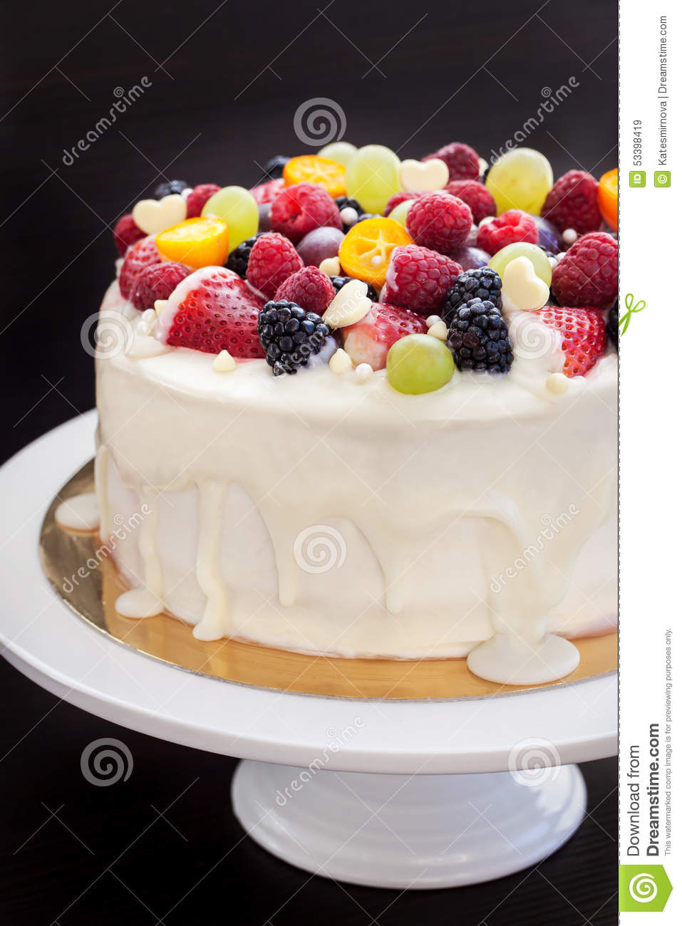 White Chocolate Cake Decorated With Fresh Berries And
