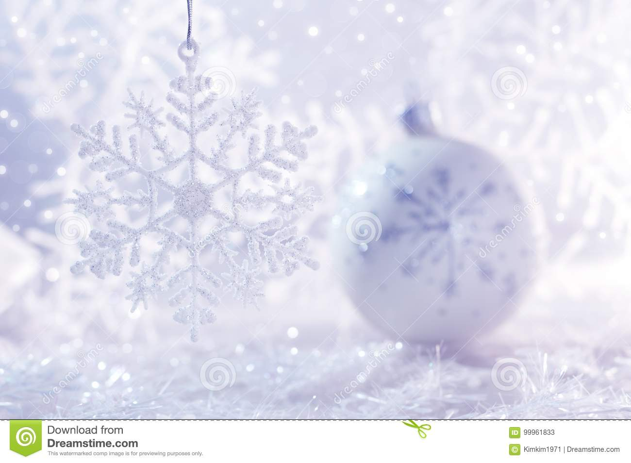 White Christmas Background.White Christmas Ball On White Background With Snowflakes And
