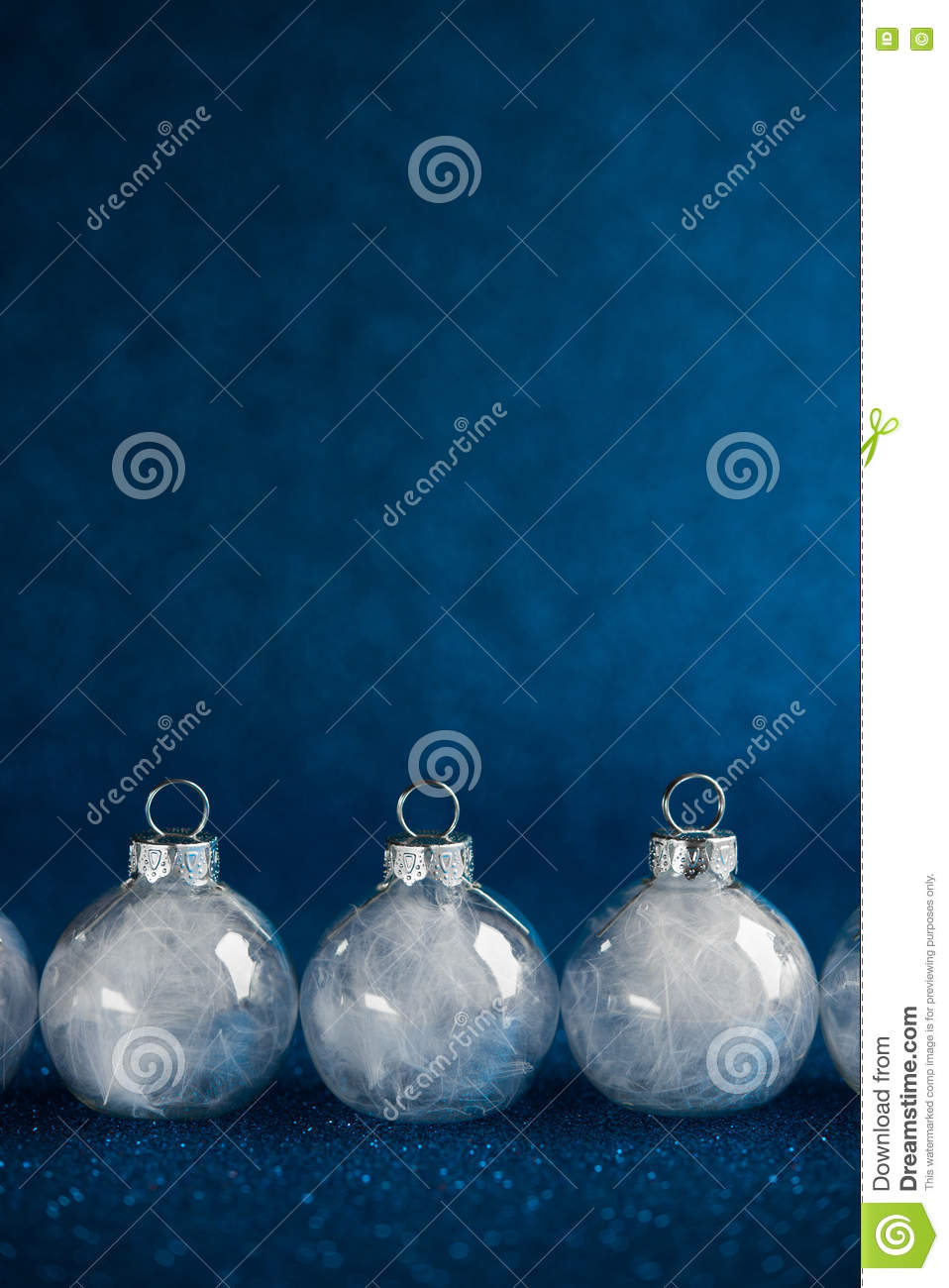 White Christmas Ornaments On Dark Blue Glitter Background With Space