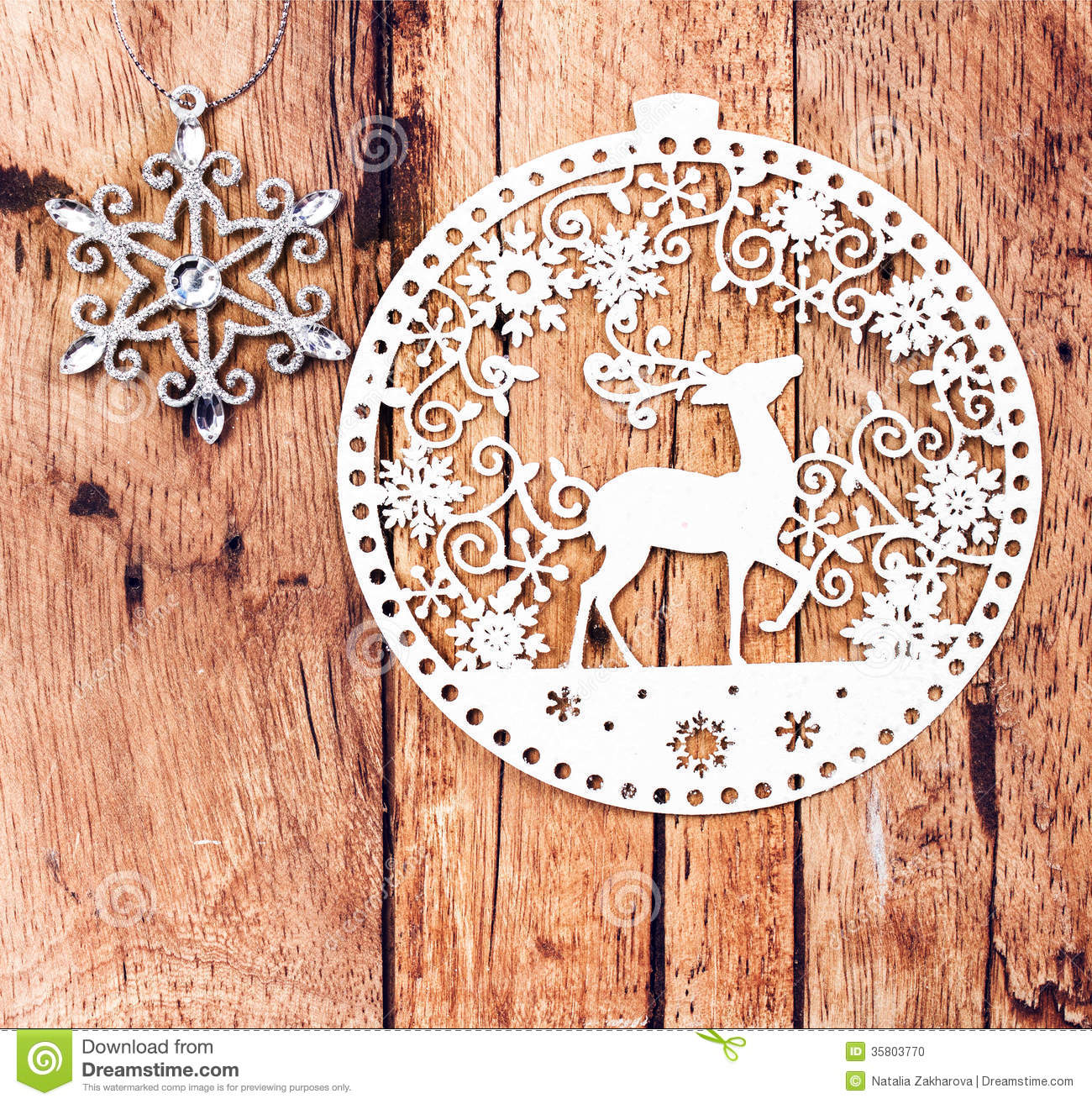 White christmas ornaments on rustic wooden board retro for Vintage rustic christmas decorations