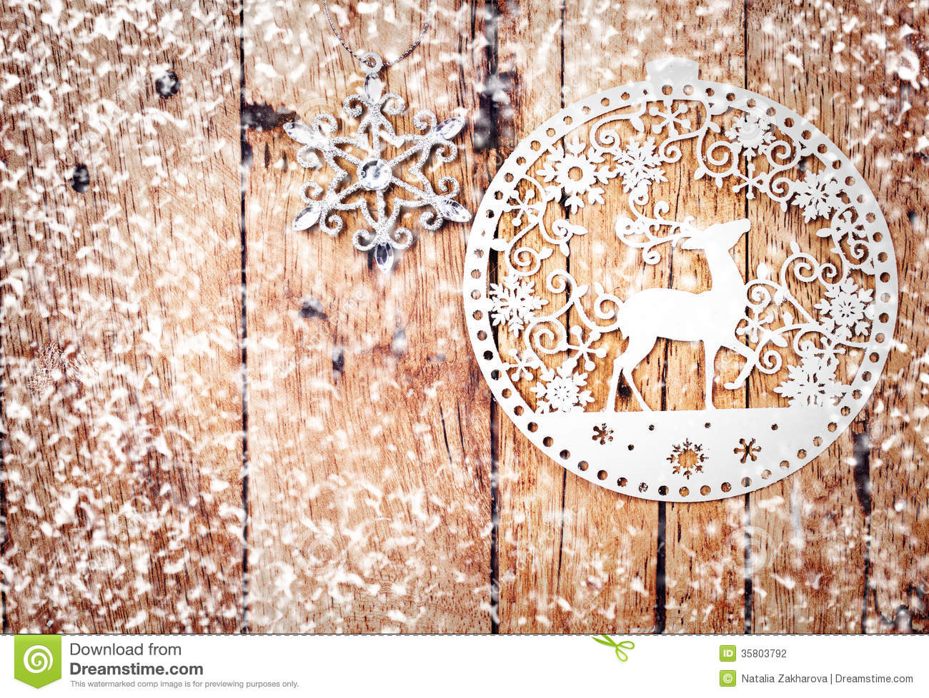 White christmas ornaments on rustic wooden board stock for Vintage rustic christmas decorations