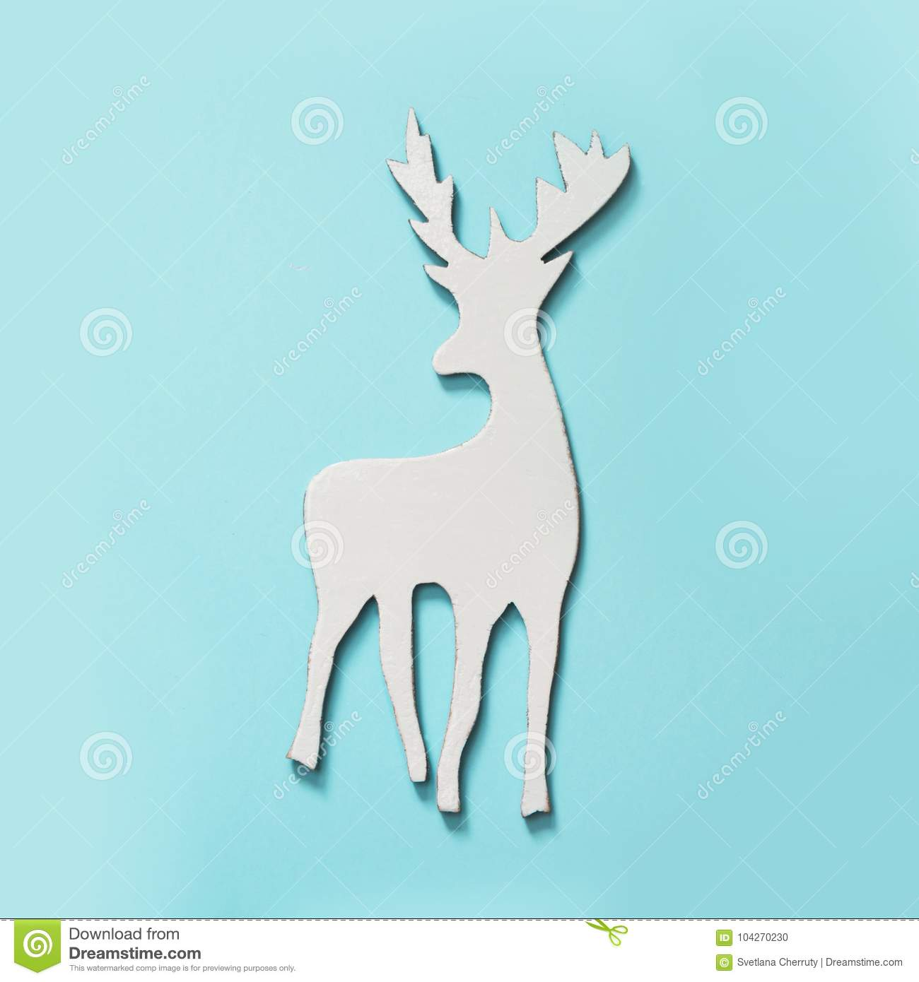white christmas reindeer with antlers on blue hipster background flat lay new year concept