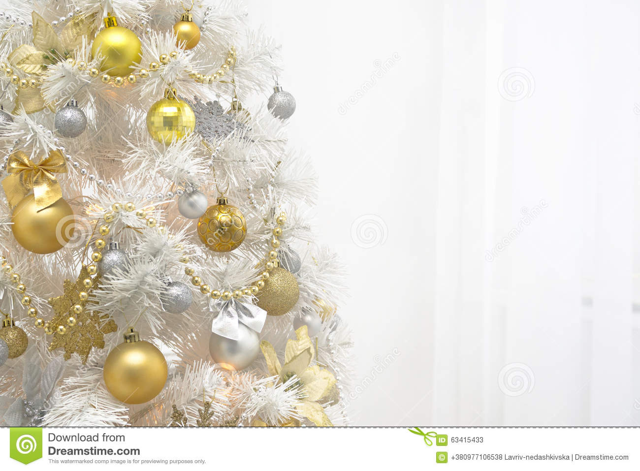 White christmas tree with gold decoration on white for Background decoration images