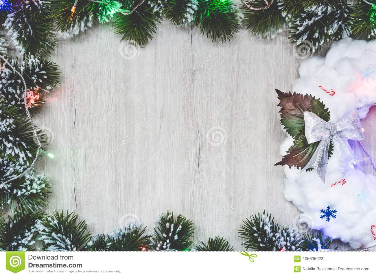 White Christmas Wreath In A Frame Of Christmas Tree Branches On A ...