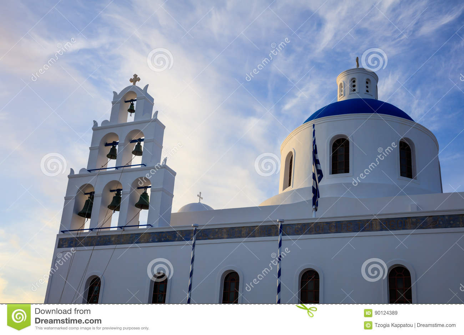 White church with blue dome in Santorini, Greece